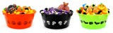 Three unique Halloween bowls filled with assorted candy