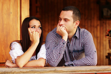 Young thinking couple looking at each other