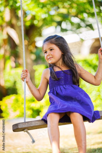 Girl Playing on Swing Set