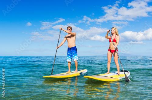 Leinwandbild Motiv Couple Stand Up Paddling in Hawaii