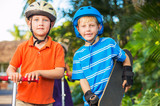 Kids with Skate Boards and Scooters