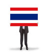 Businessman holding a big card, flag of Thailand