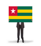 Businessman holding a big card, flag of Togo