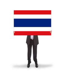 Businessman holding a big card, flag of Thailand