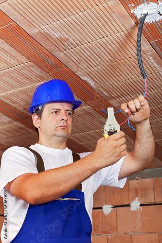 Electrician working with wiring in a new building