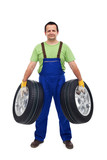 Car mechanic with two tires