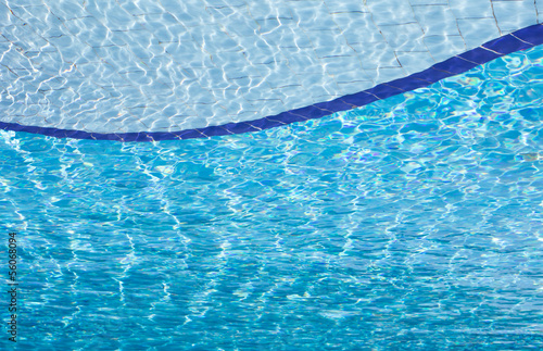 Blue clear water in swimming pool