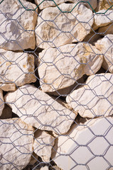 Stones of a gabion wall
