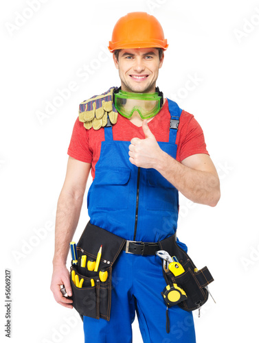 handyman with tools showing thumbs up sign