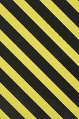 Yellow and black diagonal stripes