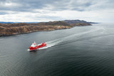 Small Norwegian red oil products tanker ship in the fjord