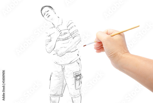hand with paintbrush painting a man photo
