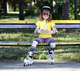 little girl with roller skates and water