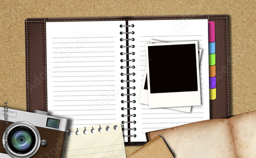Workspace with notebook ,classic camera,instant photos, note pap