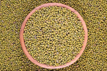 Green mung beans in a wooden bowl