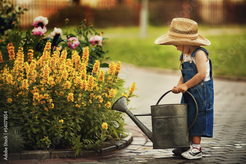 cute little boy watering flowers watering can - 56071854