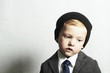 sad little boy in suit.style kid. fashion children. emotion