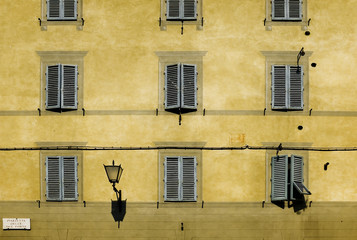 Facade with windows of Tuscan architecture. Siena, Italy