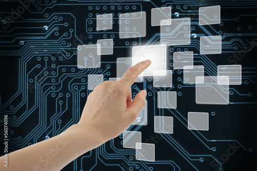 Woman hand using touch screen interface