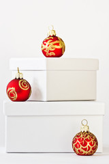 White giftboxes and red christmas ornaments