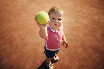 little funny girl with tennis ball