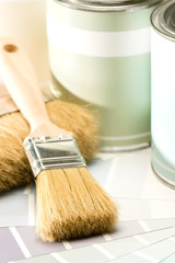 Selection of painting supplies brush and can