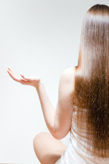 Young woman with long beautiful hair sitting in yoga pose