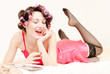 Happy young woman in lingerie at home laughing