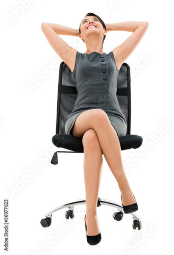 Comfortable business woman on a chair