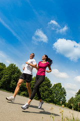 Low angle view of couple running outdoors