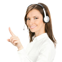 Young phone operator in headset pointing