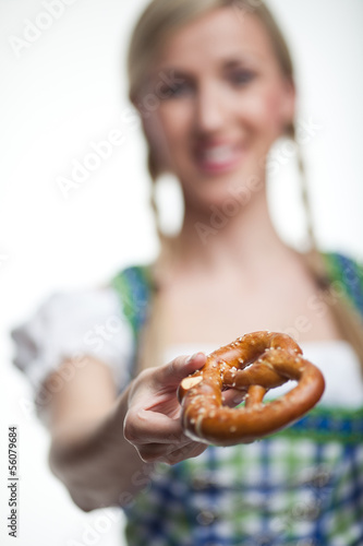Woman with a crisp baked pretzel