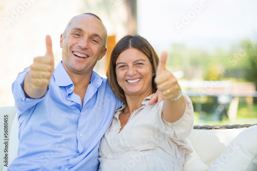 Mature Couple Showing Thumbs Up