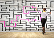 Businesswoman solving maze problem
