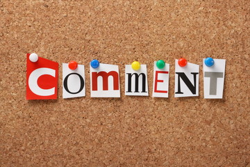 The word Comment on a cork notice board
