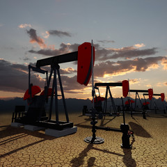 Oil pumps on the sunset sky