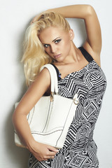 Fashion beautiful blond woman with handbag. shopping. beauty