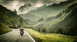 Leinwandbild Motiv Motorcyclist on mountainous highway