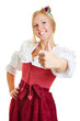 Woman in dirndl holding thumbs up