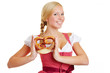 Happy woman in dirndl with pretzel
