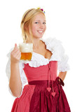 Woman in dirndl drinking beer