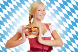 Woman with pretzel in a dirndl