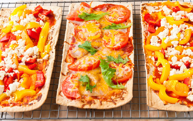 Backed flatbread with variety of toppings.