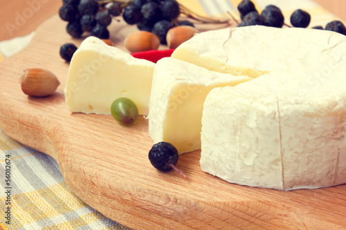 yummy sliced camembert cheese on a wooden board