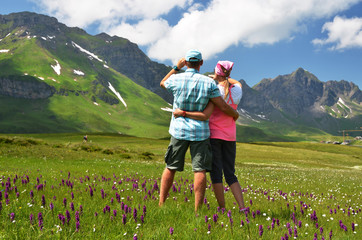 Travelers in an Alpine meadow. Melchsee-Frutt, Switzerland