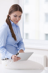 Beautiful businesswoman using tablet computer