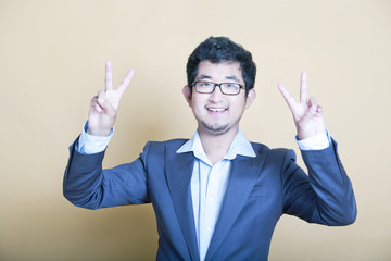 Stylish Asian man making 'peace' symbols