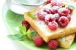 fresh toasted toast with raspberries and powdered sugar