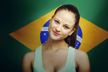 Beautiful Young woman smiling standing in front of Brazilian flag