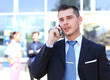 happy successful young business man talking on cell phone